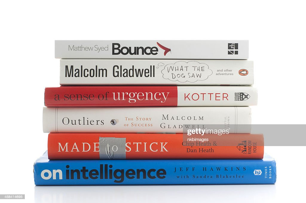 Popular Adult Nonfiction Books Piled Against White Background Stock