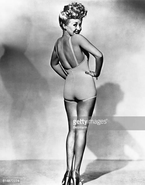 Popular American movie actress Betty Grable models a bathing suit in the most famous pinup photo of World War II