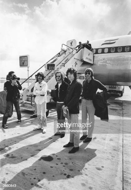 Popular American rock group The Doors standing beside an Air India aeroplane