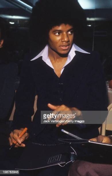Popular American singer Michael Jackson signs autographs for fans at the Dance Theatre of Harlem New York New York 1977