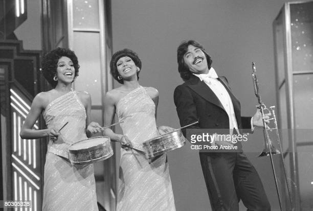 Popular American vocal group Tony Orlando and Dawn smile as they perform on an episode of their television variety show 'The Tony Orlando and Dawn...