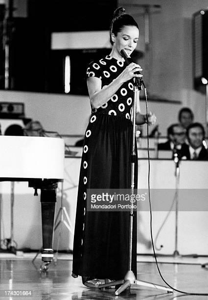 Popular announcer Aba Cercato carefully adjusts the microphone on stage during a rehearsal in a studio in the occasion of the 8th International...