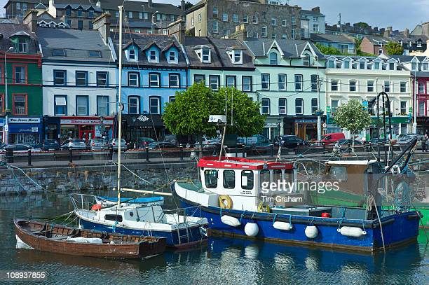 Popular as a tourist destination Cobh harbour with brightly coloured fishing boats in County Cork Ireland