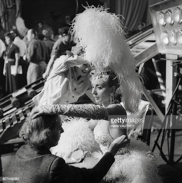 Popular Belgian actress and singer Annie Cordy has her costume adjusted before going on stage at the Lido club in Paris