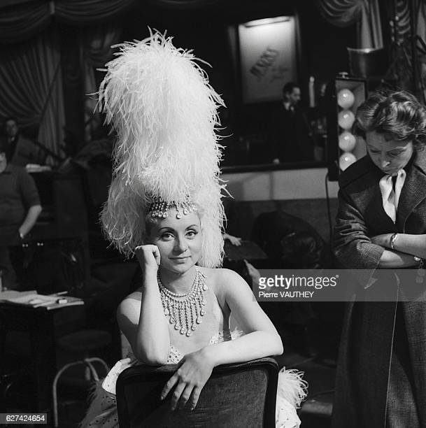 Popular Belgian actress and singer Annie Cordy sits in her elaborate costume before going on stage at the Lido club in Paris