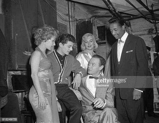 Popular DJ Alan Freed is surrounded by Jo Ann Campbell Frankie Avalon Inga Freed and Nate Nelson of the Flamingoes Alan Freed is seated in the center