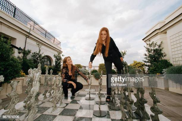 Popular English television actress Jane Seymour and her daughter Katie play with a large chess board on a rooftop patio in Paris