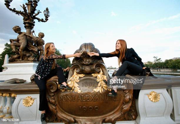 Popular English television actress Jane Seymour and her daughter Katie make a champagne toast as they sit on the railing of the AlexandreIII bridge...