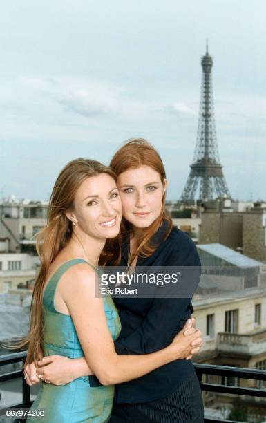 Popular English television actress Jane Seymour hugs her daughter Katie on a balcony with a view of the Eiffel Tower