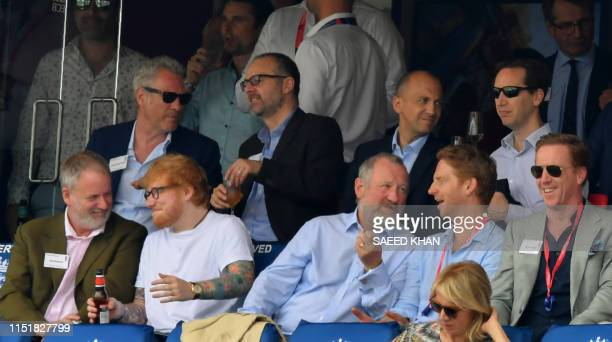 Popular entertainer Ed Sheeran sits with others in the stands during the 2019 Cricket World Cup group stage match between England and Australia at...