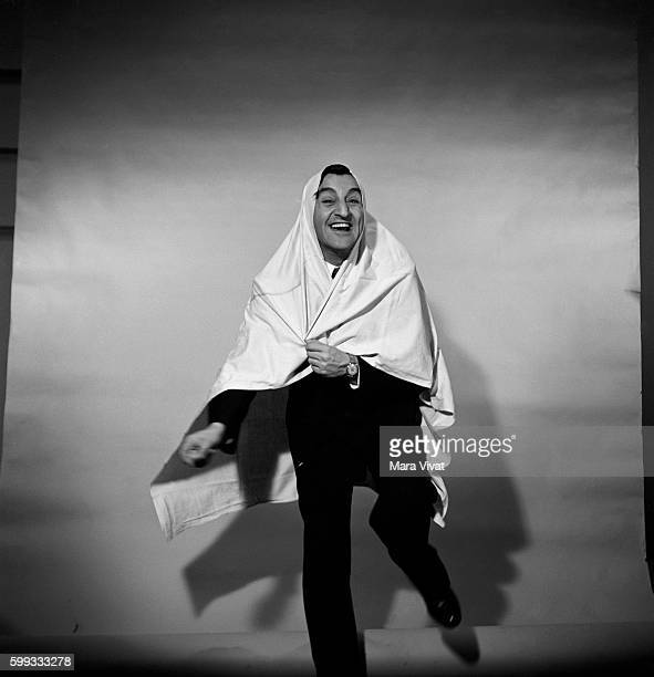 Popular fifities television actor Danny Thomas laughs with a bed sheet draped on his head