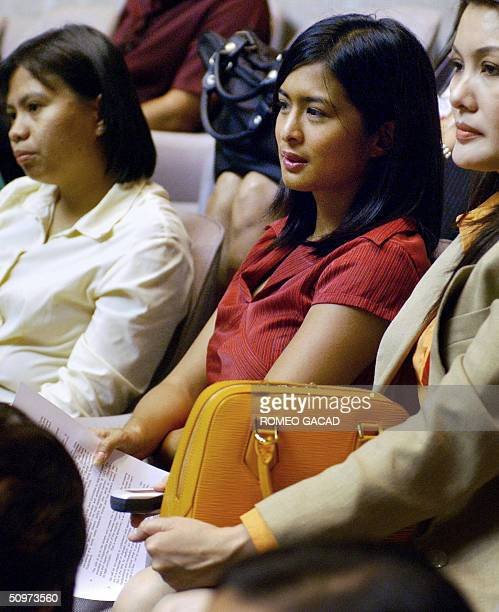 Popular Filipina sexy movie actress Joyce Jimenez attends the joint senate and congressional count of the presidential elections at the House of...