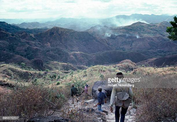 Popular Forces of Liberation guerrillas patrol territory near the Honduran border El Salvador February 22 1981 At the time the country was engaged in...
