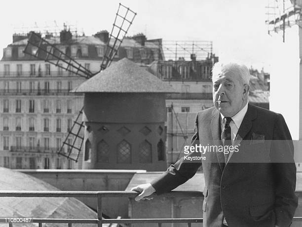 Popular French poet and songwriter Jacques Prevert poses near the Moulin Rouge in Paris circa 1977