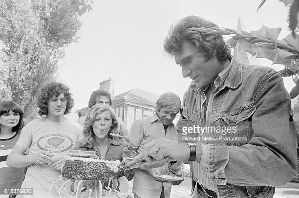 Popular French rock musician Johnny Hallyday celebrates his 33rd birthday with his friends in Feucherolles, France.