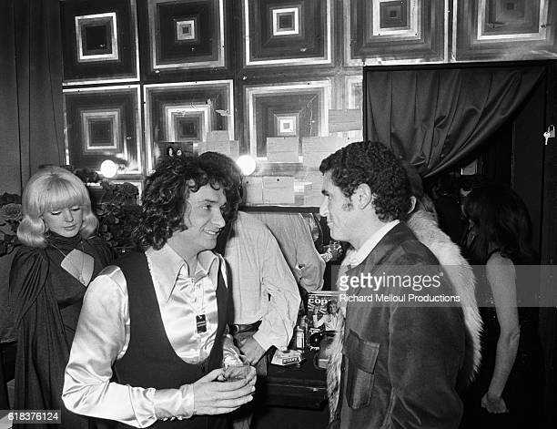 Popular French singer Michel Sardou chats with director Claude Lelouch backstage at the Olympia in Paris Sardou was joined by many of his prominent...