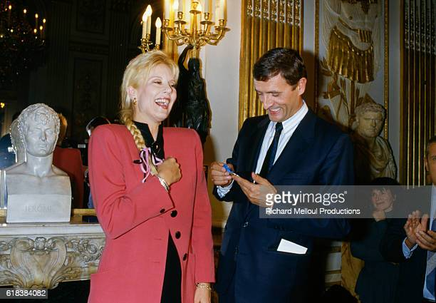 Popular French singer Sylvie Vartan is made a member the Ordre National du Merite by French minister of culture Francois Leotard. The Ordre National du Merite is France's highest civilian honor.
