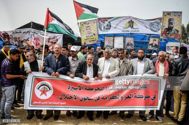 Popular Front for the Liberation of Palestine's supporters hold banners as they gather to stage a protest to show solidarity with detainee...