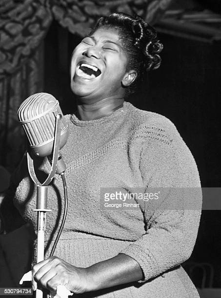 Popular gospel singer Mahalia Jackson singing into a microphone She won acknowledgement as the finest gospel singer of her day and helped popularize...