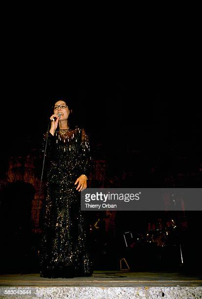 Popular Greek singer Nana Mouskouri sings during a concert at the Odeion of Herodes Atticus in Athens The 1984 performance was Mouskouri's first...