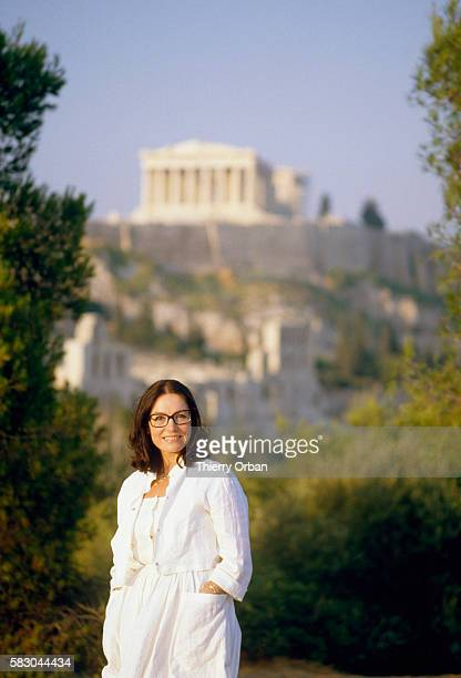 Popular Greek singer Nana Mouskouri stands on a hill in Athens In the background can be seen the Parthenon