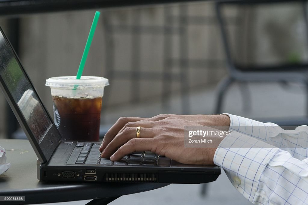 A popular internet obsession is surfing the net while having coffee in The Manhattan Borough of New York, New York, USA.