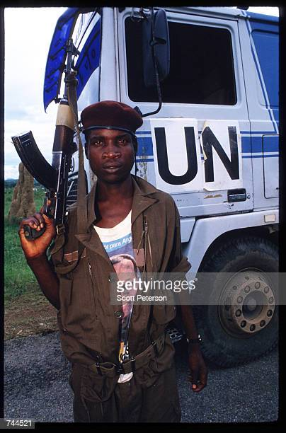 Popular Liberation Movement of Angola soldier guards United Nations food convoys March 24 1993 in Huambo Angola Despite a 1991 peace treaty the West...