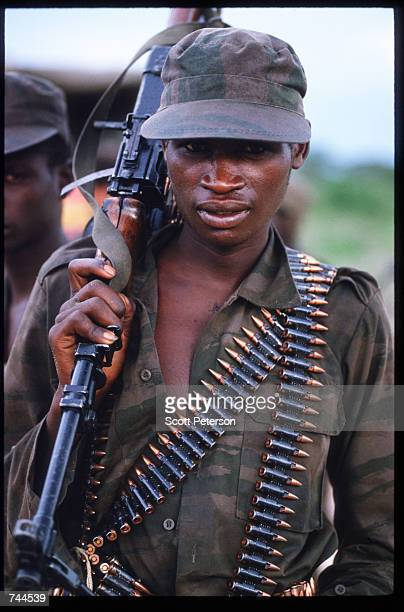 Popular Liberation Movement of Angola soldier poses while guarding United Nations food convoys March 24 1993 in Huambo Angola Despite a 1991 peace...