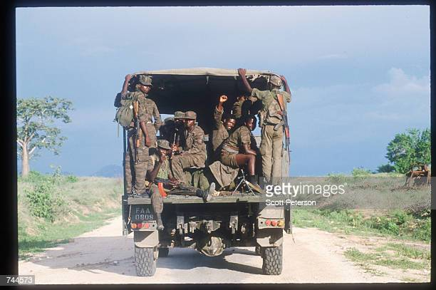 Popular Liberation Movement of Angola soldiers guard United Nations food convoys March 24 1993 in Huambo Angola Despite a 1991 peace treaty the West...
