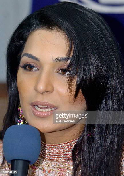 Popular Pakistani actress Meera answers a question during a press conference in Karachi 05 October 2005 Meera whose life was threatened over acting...