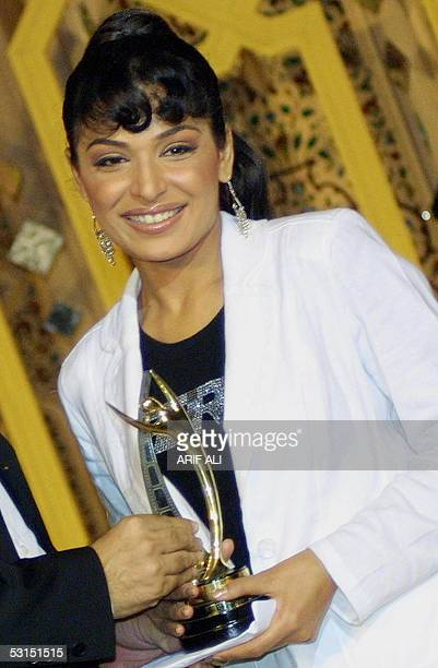 Popular Pakistani film actress Meera holds her award during the first Pakistan National Film Awards ceremony in Lahore late 25 June 2005 The awards...