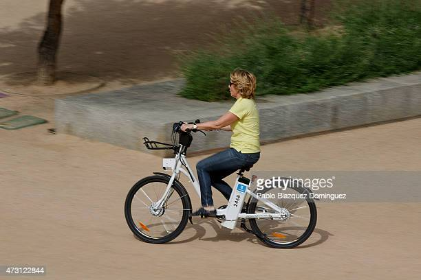 Popular Party candidate for Madrid's mayorality Esperanza Aguirre rides on bicycle during an election campaign event at Madrid Rio on May 13 2015 in...