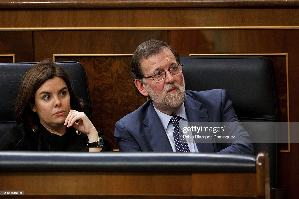 Popular Party (People's Party) leader Mariano Rajoy (R) and Soraya Saenz de Santamaria (L) listen the speech of Spanish Socialist Party (PSOE) leader Pedro Sanchez, (not in the picture) during a debate to form a new government at the Spanish Parliament on March 1, 2016 in Madrid, Spain. The Spanish Socialist Party leader appeals for support ahead of the investiture debate to get enough votes from the other 349 deputies that would allow him to become Prime Minister. The Spanish political system requires Sanchez to achieve an overall majority in the vote, which follows the debate. If he fails to realise that in the first vote, a simple majority would be enough to make him Prime Minister in a second vote to be held 48 hours later.