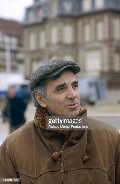 Popular singer and actor Charles Aznavour stands on the set of the 1982 French film Qu'estce Qui Fait Courir David The film written and directed by...