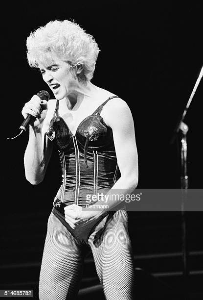 Popular singer Madonna performs in a bustier for a AIDS benefit concert in Madison Square Garden.