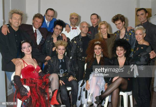 Popular singers Johnny Hallyday and Sylvie Vartan stand with the cast of the musical Starmania by composer Luc Plamondon