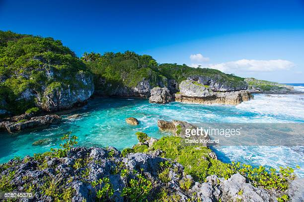 a popular swimming spot on niue island; niue - niue island stock photos and pictures