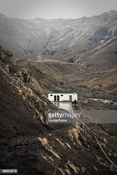 Popular tourist attraction for mountain climbers, Seljavallalaug, a swimming pool in a valley in the Eyjafjoll mountain range is covered by a thick...