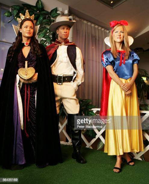 Popular tourist attraction Madame Tussauds unveils its seasonal waxwork scene featuring models of Angelina Jolie as the Wicked Step Mother Brad Pit...
