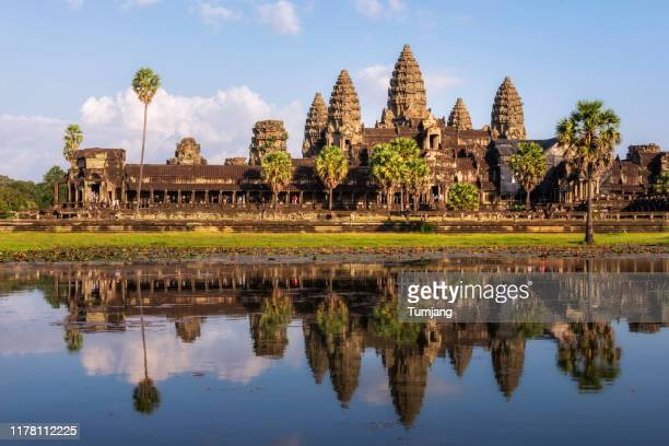 popular view for tourist attraction ancient temple complex angkor wat with reflected in lake siem reap, cambodia - アンコールワット ストックフォトと画像