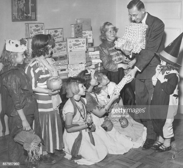 A popular visitor at the Denver Orphans home Tuesday was ER Bradley manager of SaveonDrugs 1625 Stout street Bradley is shown distributing candy to...