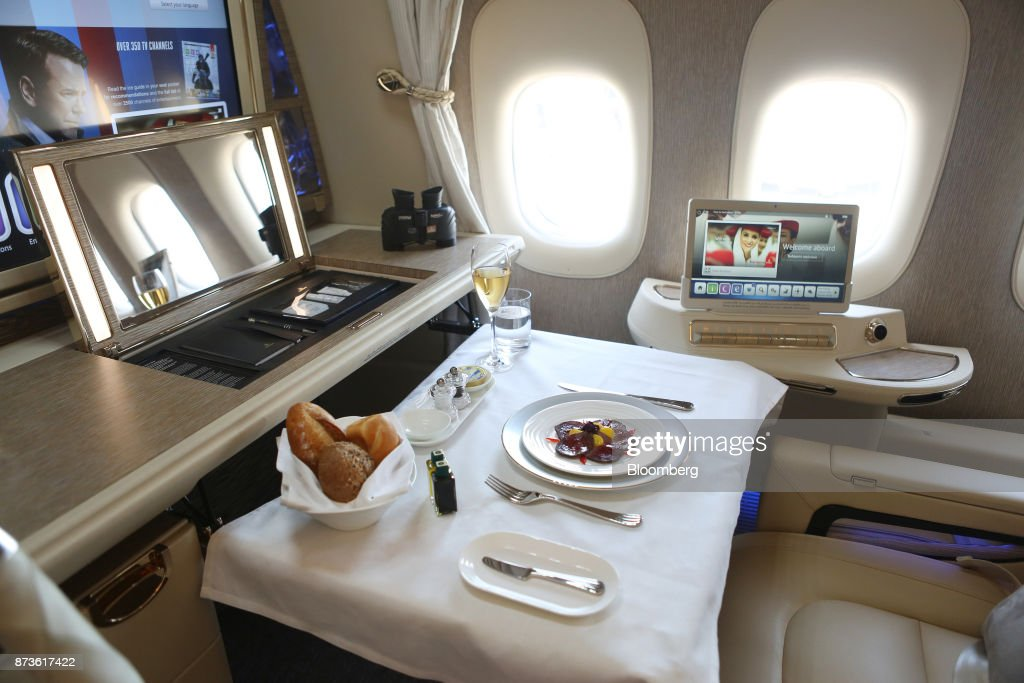 A pop-up mirror and a meal sit in a first class cabin on board a Boeing Co. 777 passenger aircraft, operated by Emirates Airlines, during the 15th Dubai Air Show at Dubai World Central (DWC) in Dubai, United Arab Emirates, on Monday, Nov. 13, 2017. The biennial Dubai expo is an important venue for manufacturers to secure deals for their biggest and most expensive jetliners. Photographer: Natalie Naccache/Bloomberg via Getty Images