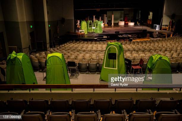 Pop-up tents are seen in an auditorium at Wenatchee High School on February 26, 2021 in Wenatchee, Washington. The school has been using pop-up tents...