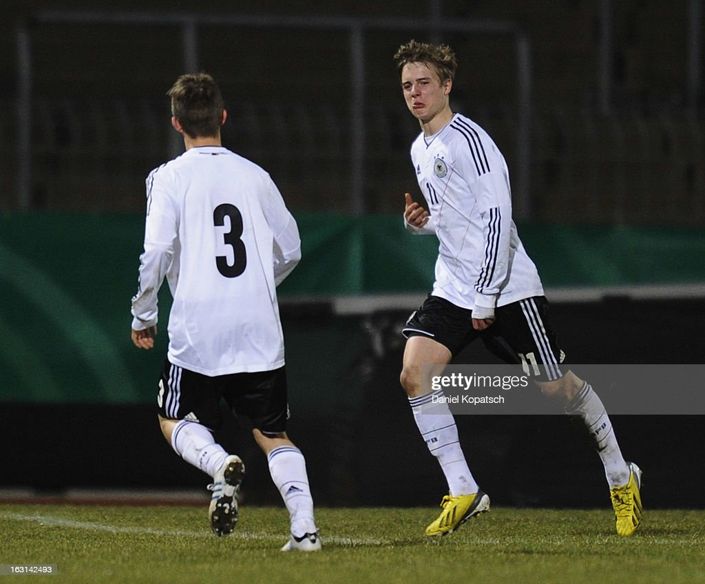 Porath Finn of Germany (R) celebrates his team's third goal with team mate David Kammerbauer during the U16 international friendly match between Germany and Italy on March 5, 2013 at Waldstadion in Homburg, Germany.