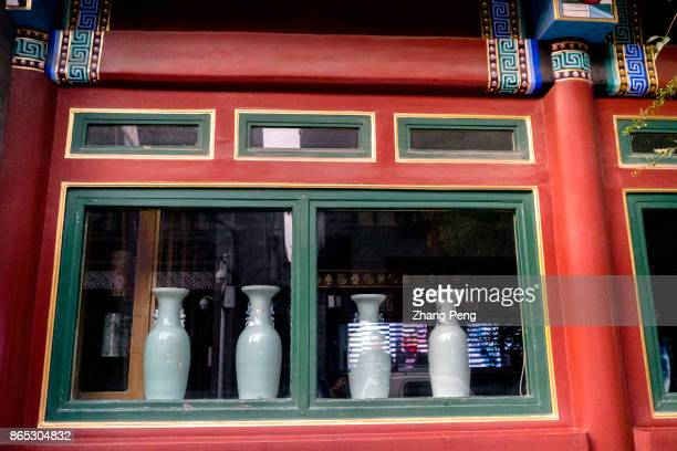 Porcelain bottles on a shop window sill Liulichang cultural Street originated in the Qing Dynasty when candidates to participate in the imperial...