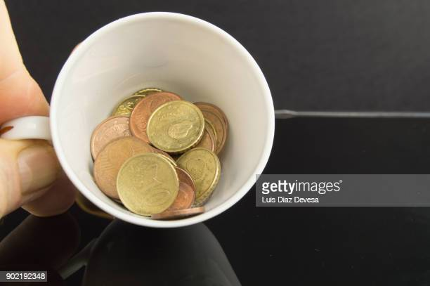 Porcelain cup fills of coins