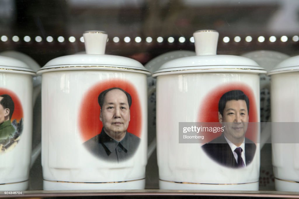 Porcelain cups featuring portraits of Chinese President Xi Jinping, right, and former Chinese leader Mao Zedong stand on display at a store window in Beijing, China, on Monday, Feb. 26, 2018. China's Communist Party is set to repeal presidential term limits in a move that would allowXi to rule beyond 2023, completing the country's departure from a political system based on collective leadership. Photographer: Giulia Marchi/Bloomberg via Getty Images