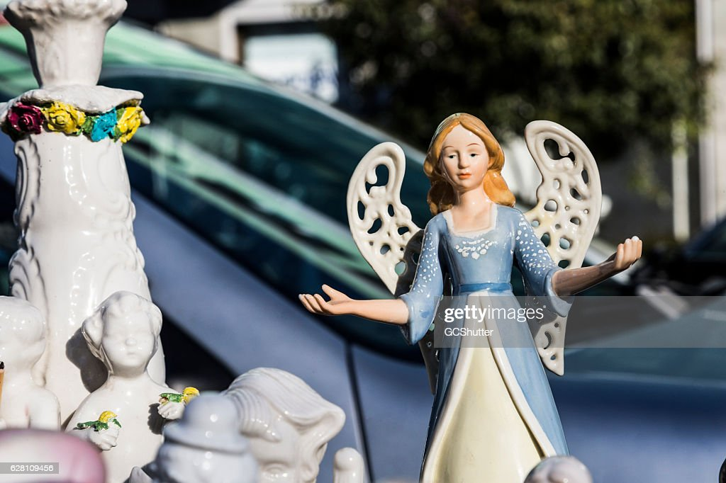 porcelain dolls for sale at a flea market store stock photo getty