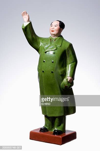 Porcelain figurine of Mao Tse-tung on white background, close-up