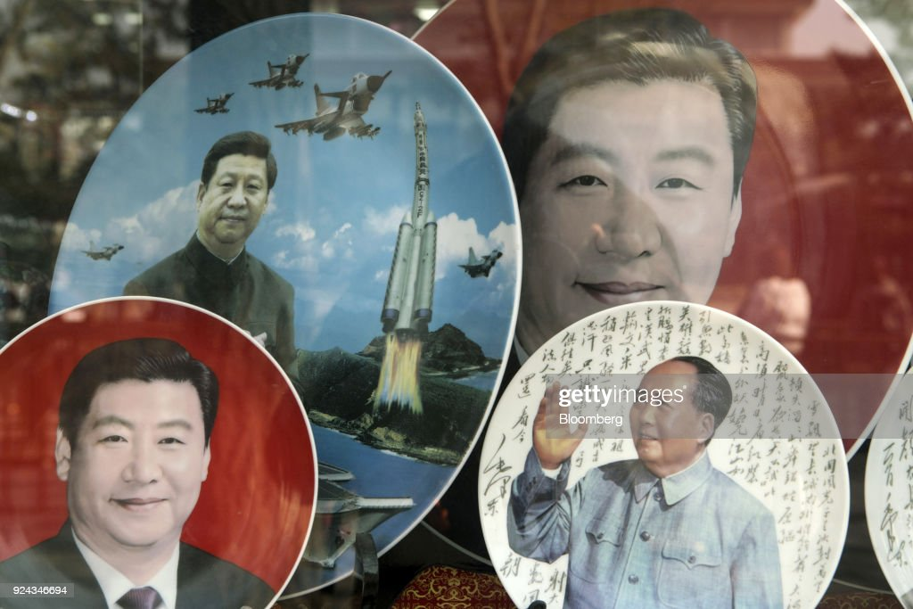 Porcelain plates featuring portraits of former Chinese leader Mao Zedong, bottom right, and Chinese PresidentXi Jinping stand on display at a store window in Beijing, China, on Monday, Feb. 26, 2018. China's Communist Party is set to repeal presidential term limits in a move that would allowXi to rule beyond 2023, completing the country's departure from a political system based on collective leadership. Photographer: Giulia Marchi/Bloomberg via Getty Images